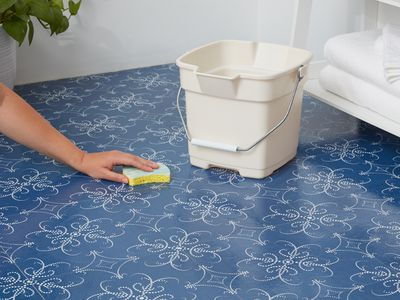 Cleaning self-adhesive floor tiles