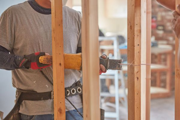 Wooden structure beams being cut by miner saw in rebuilt house