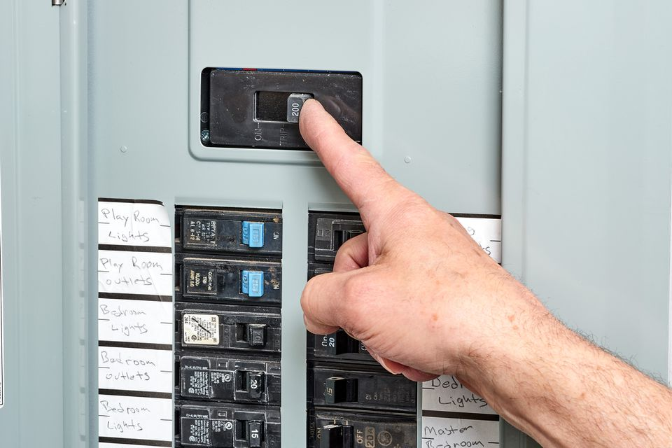 240 volt circuit breaker switch being pushed