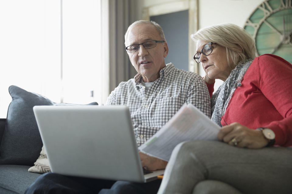 Senior couple using laptop