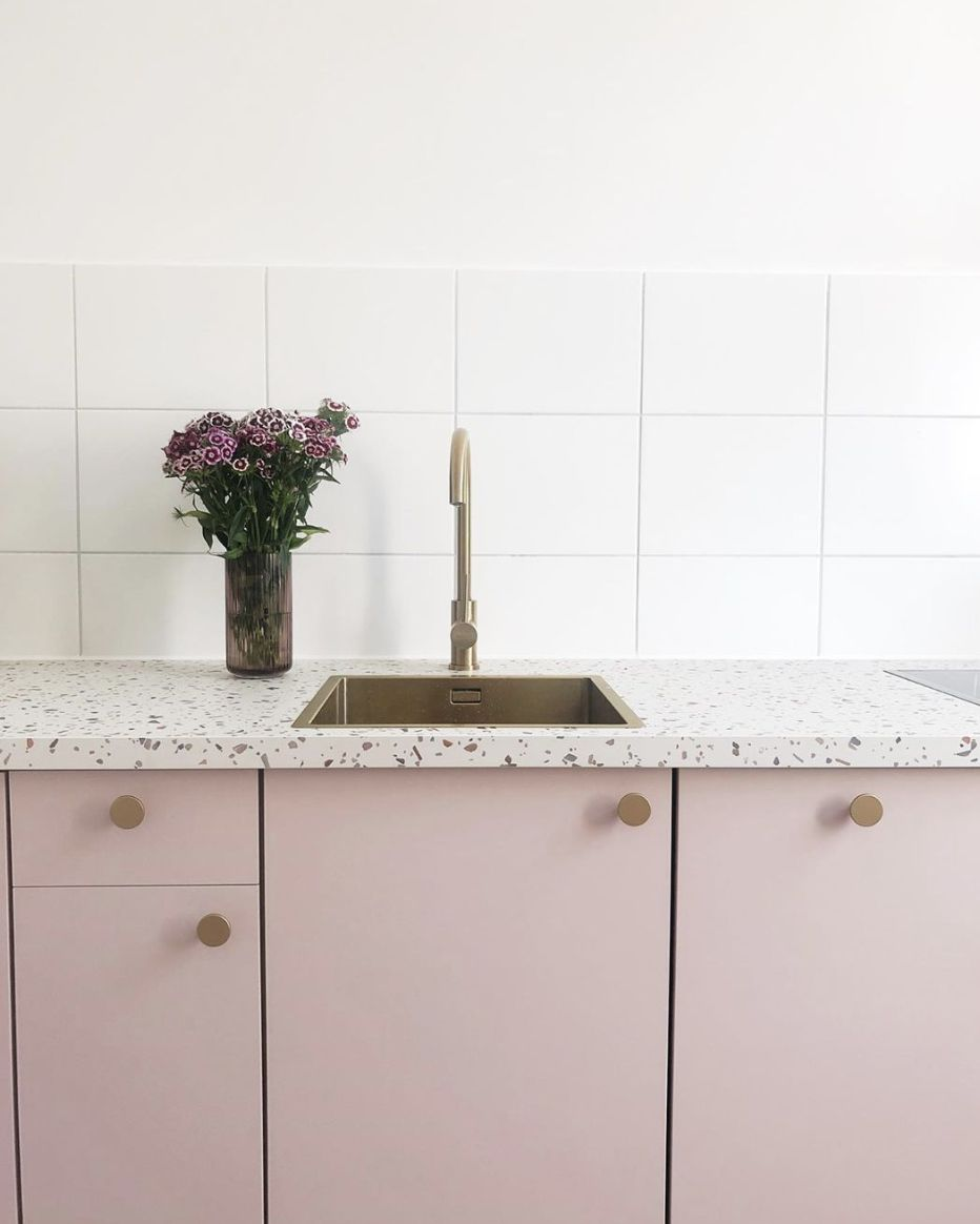 Pink cabinet with terrazzo countertop