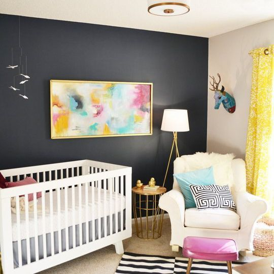 Modern, black and white nursery with colorful accents and black accent wall