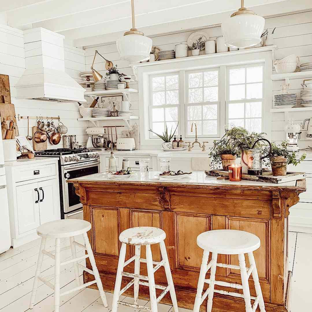 White kitchen with a wooden kitchen island