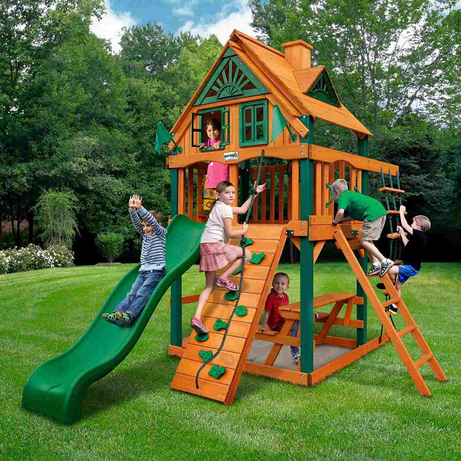 A picture of the Gorilla Playsets Chateau Treehouse Tower Swing Set - The 8 Best Wooden Swing Sets And Playsets To Buy In 2018