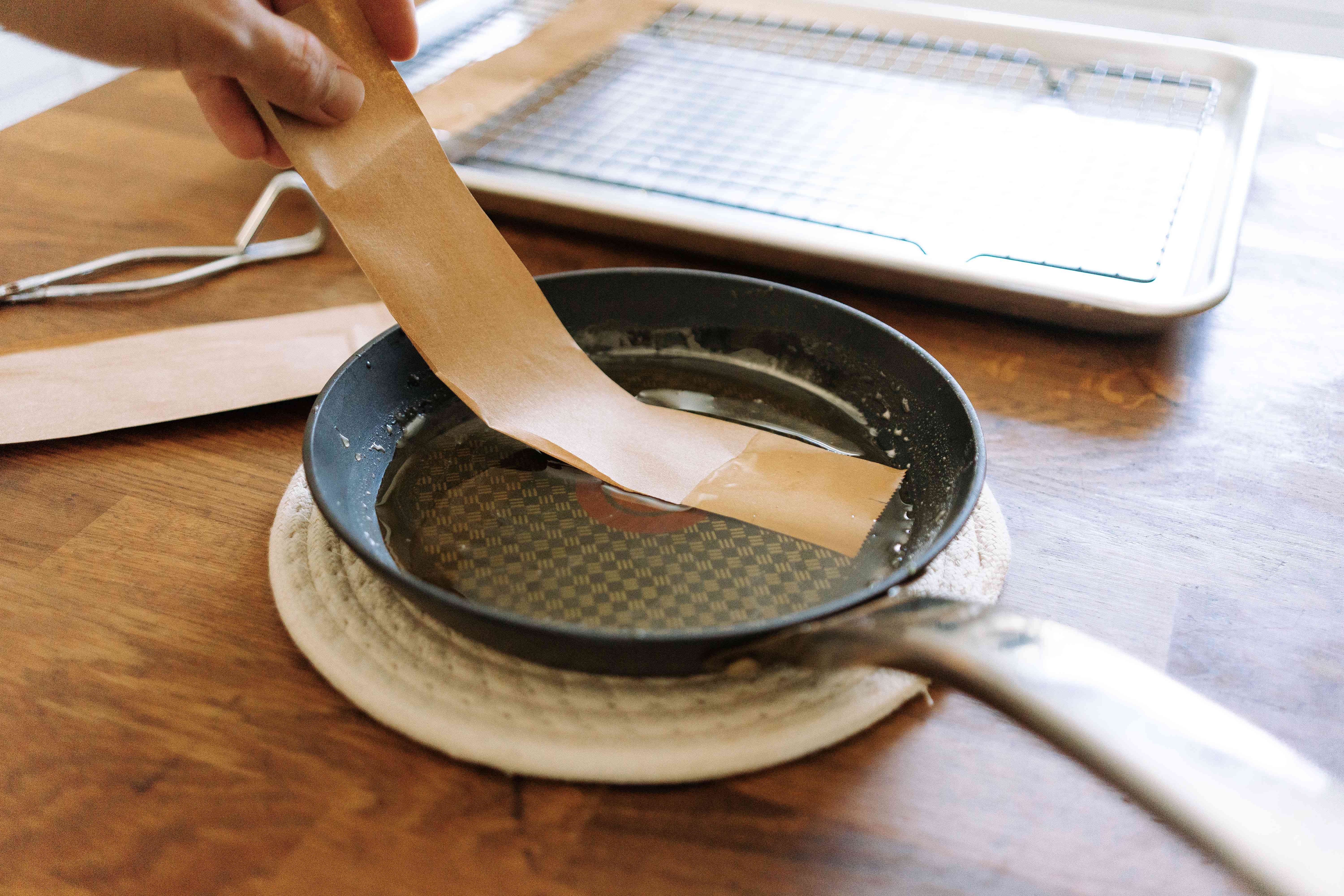 dipping paper bag strips into the sugar mixture