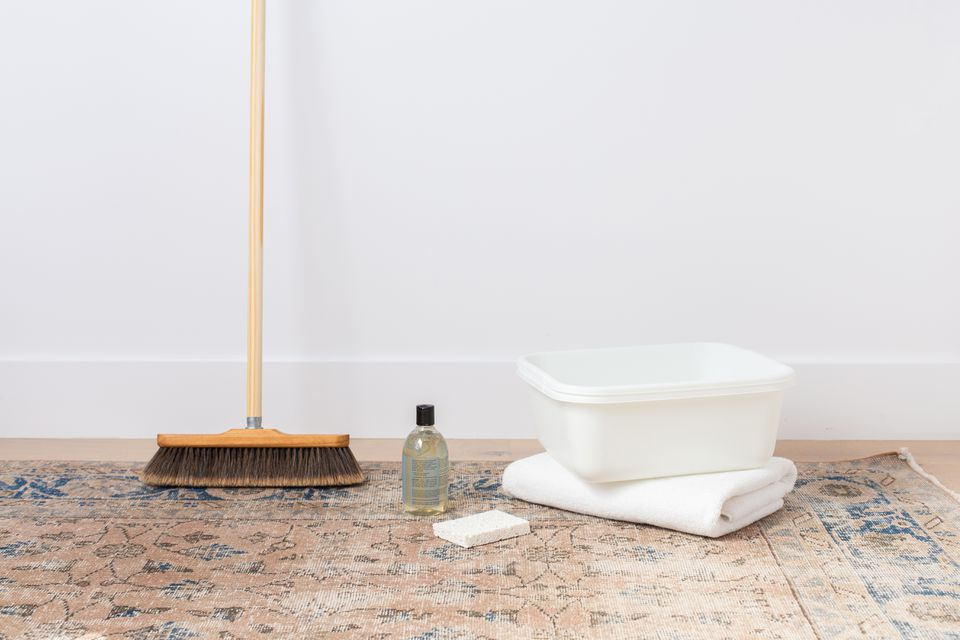 Wool rug with broom, bucket, towel, sponge and wool wash detergent for cleaning