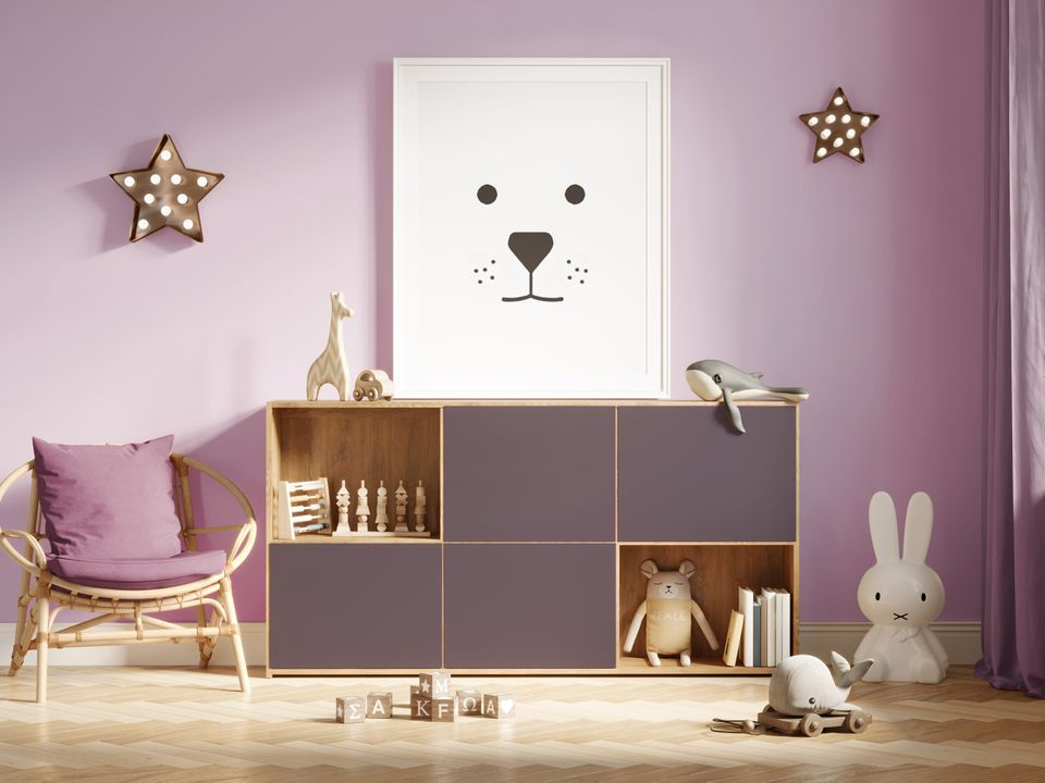 3d Mockup nursery interior with a frame with minimal print of a bear a pink furniture with toys