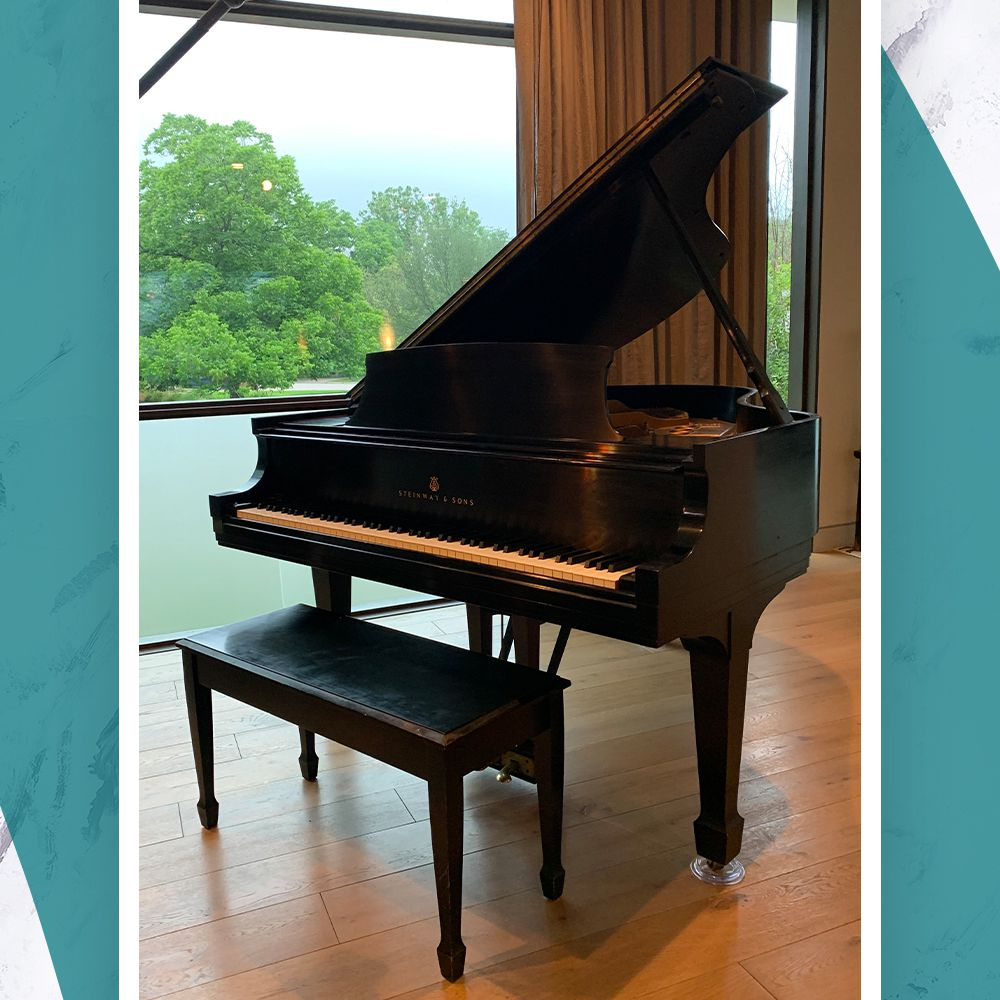 An heirloom grand piano in the WELL home of designer Laura Britt in Austin, Texas
