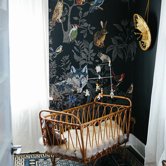 Eclectic nursery room with black walls and nature theme