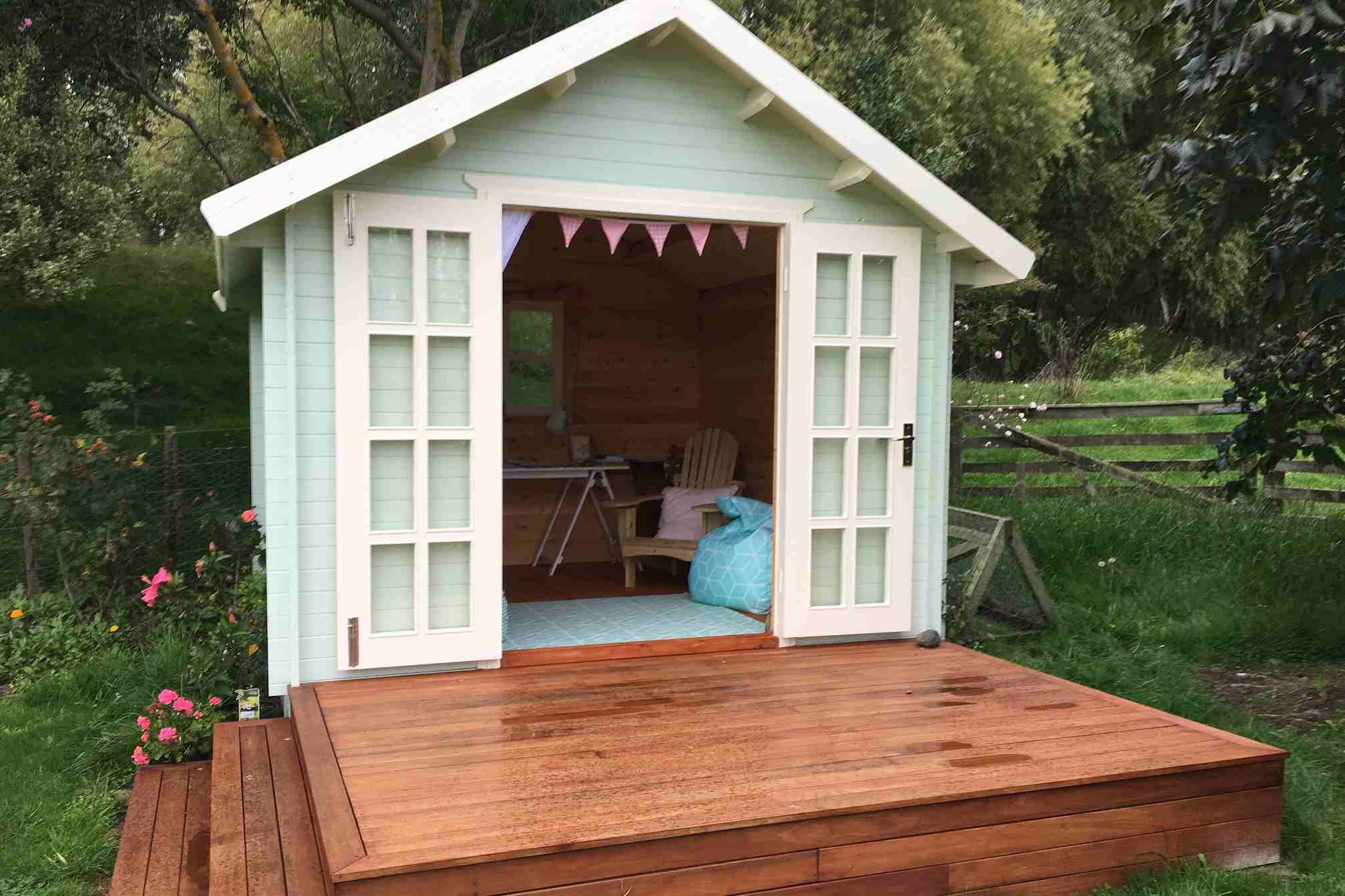 she shed with wood deck