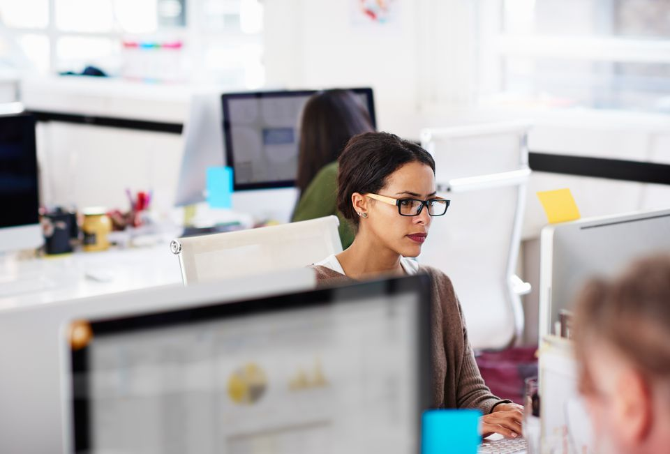 Business woman at work station in start-up office