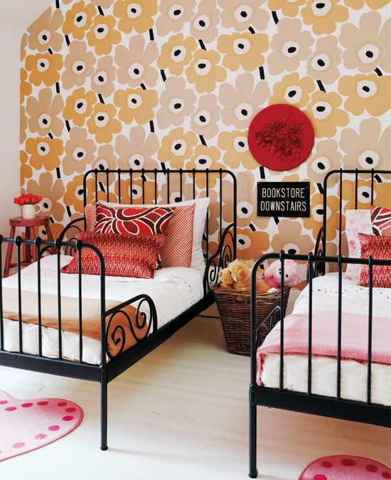 1970s vintage throwback girls' room with bold floral accent wall