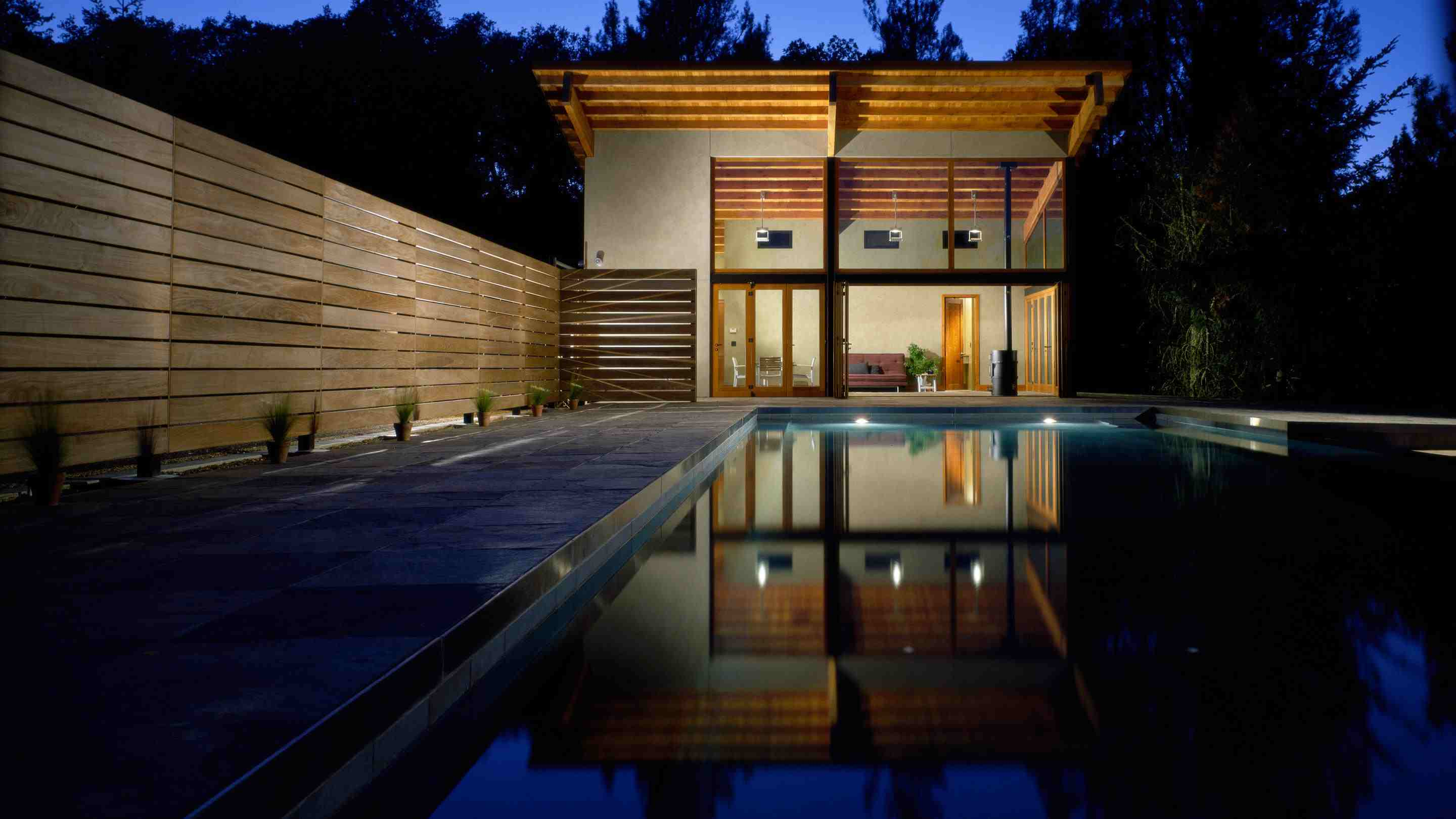 a pool house at night