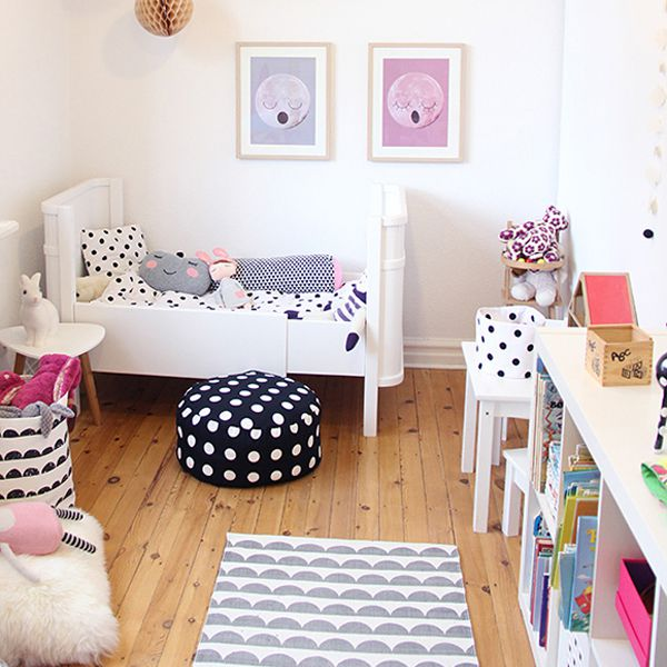 Scandinavian style girl's room with kid-friendly furniture