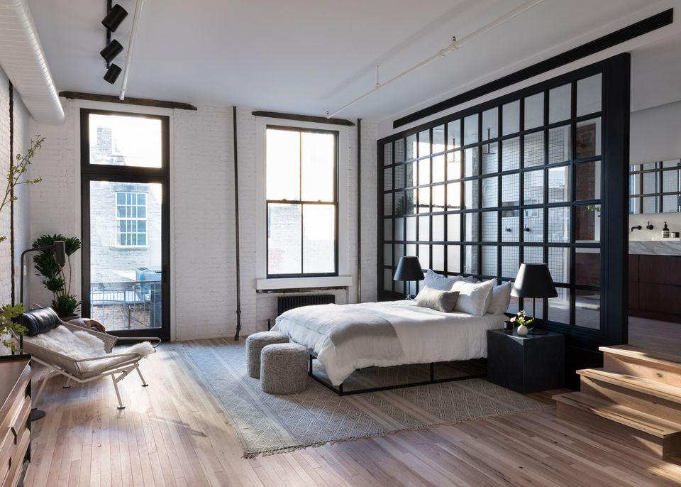 white exposed brick loft bedroom