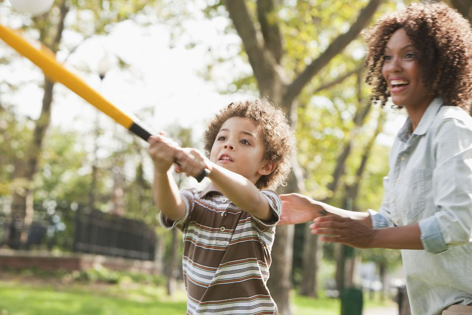 Mother and son play baseball
