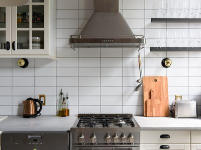 Still life of a stylishly renovated modern kitchen stove and counter