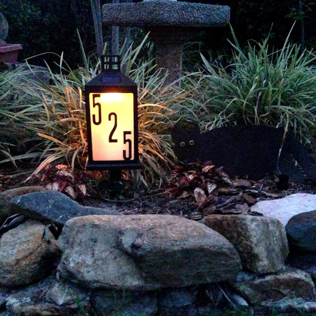 A solar lamp with address numbers on it.