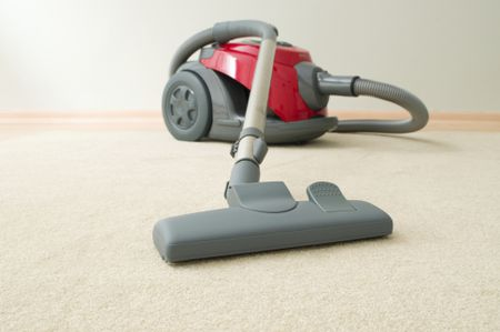 Vacuum Cleaner Resting On Carpet