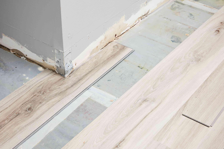 Vinyl plank cut to fit around potrusion