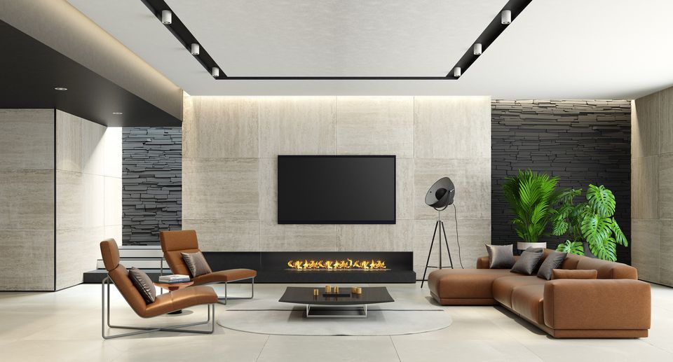 Brown leather sofa and chairs in contemporary living room