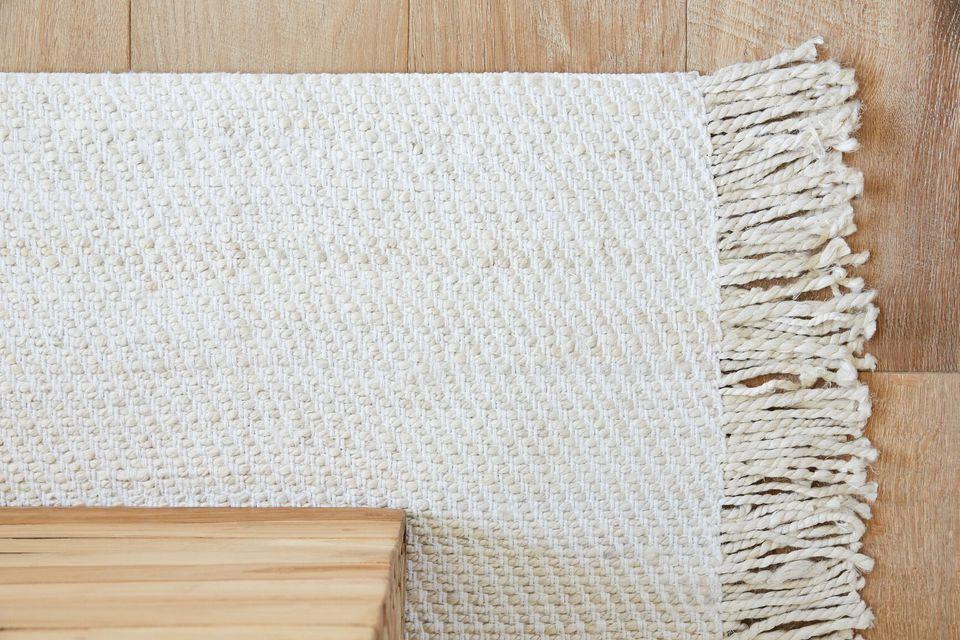 a rug beneath furniture