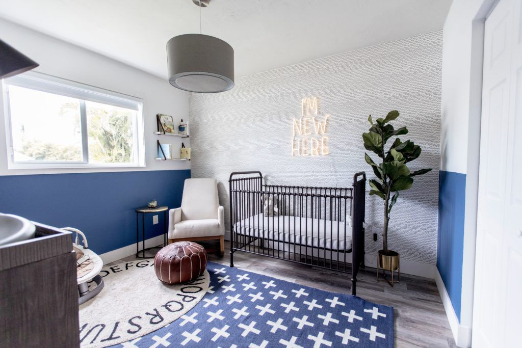 Contemporary blue nursery with half-wall paint treatment.