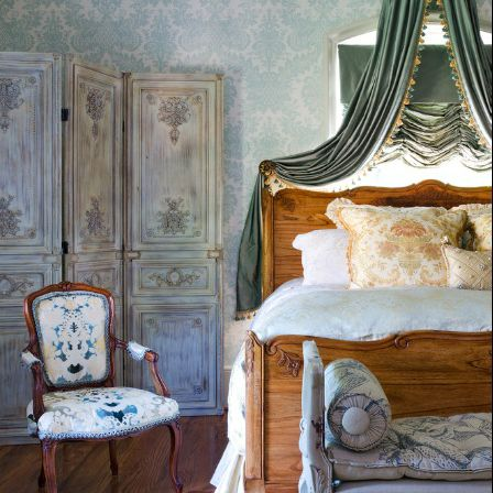 French country bedroom with canopy bed