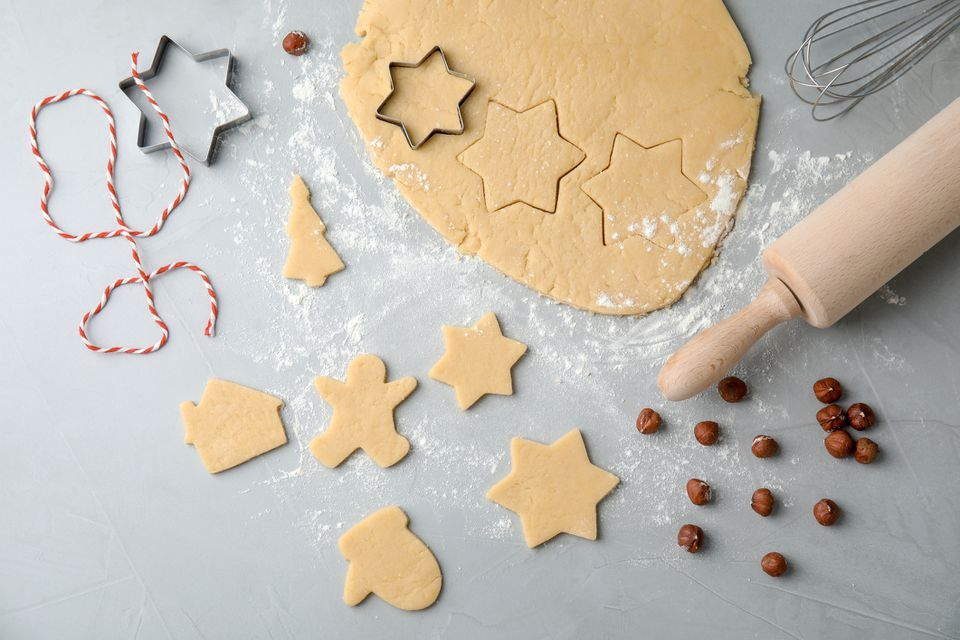 Flat lay composition with dough and cutters on table, top view. Preparing Christmas cookies