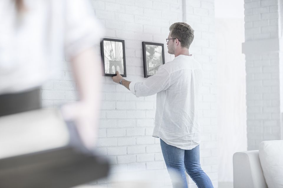 Man hanging pictures