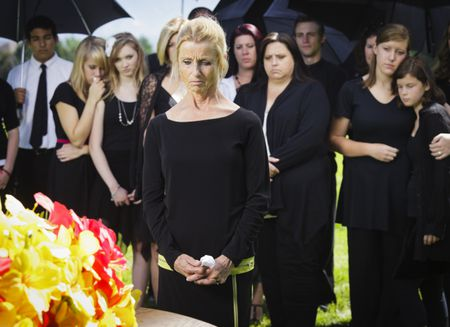 4de800e9e30f It is essential to maintain proper etiquette and good manners at a funeral.  Rich Legg / Getty Images