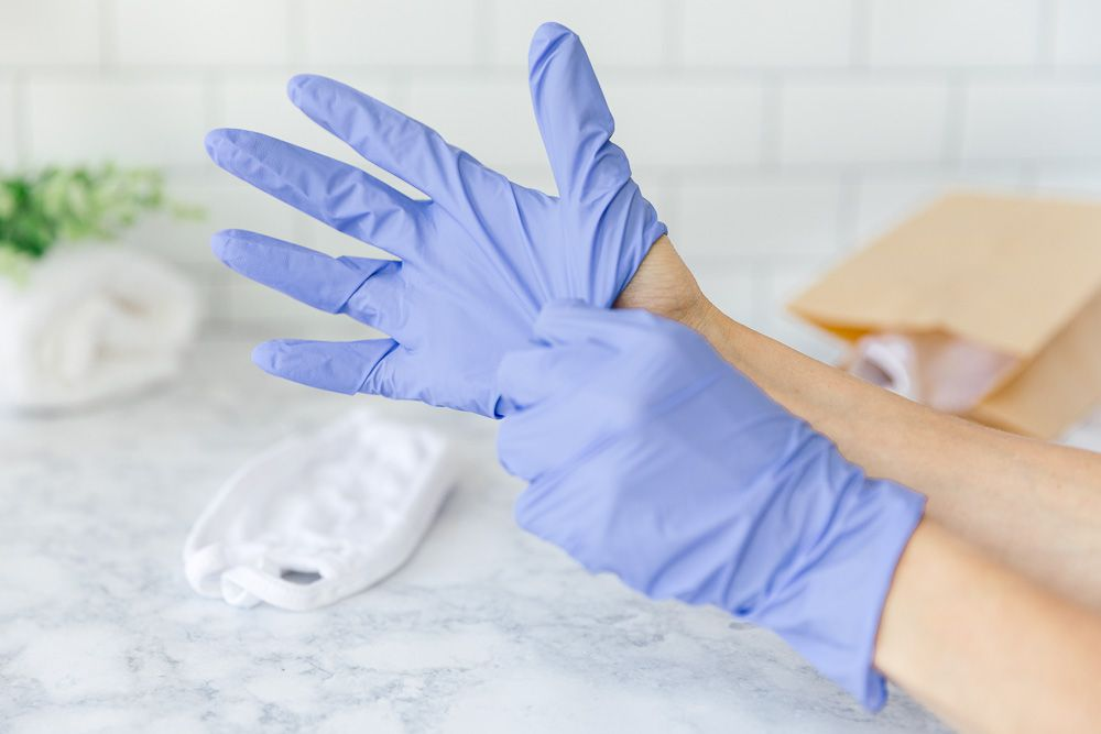 putting on disposable gloves for hand protection