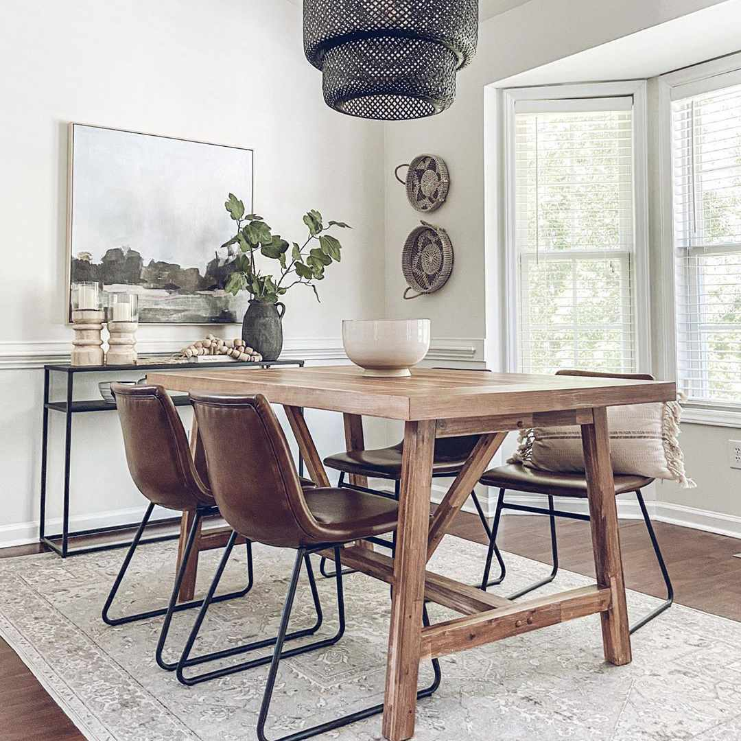 Wooden dining table with black wicker pendant