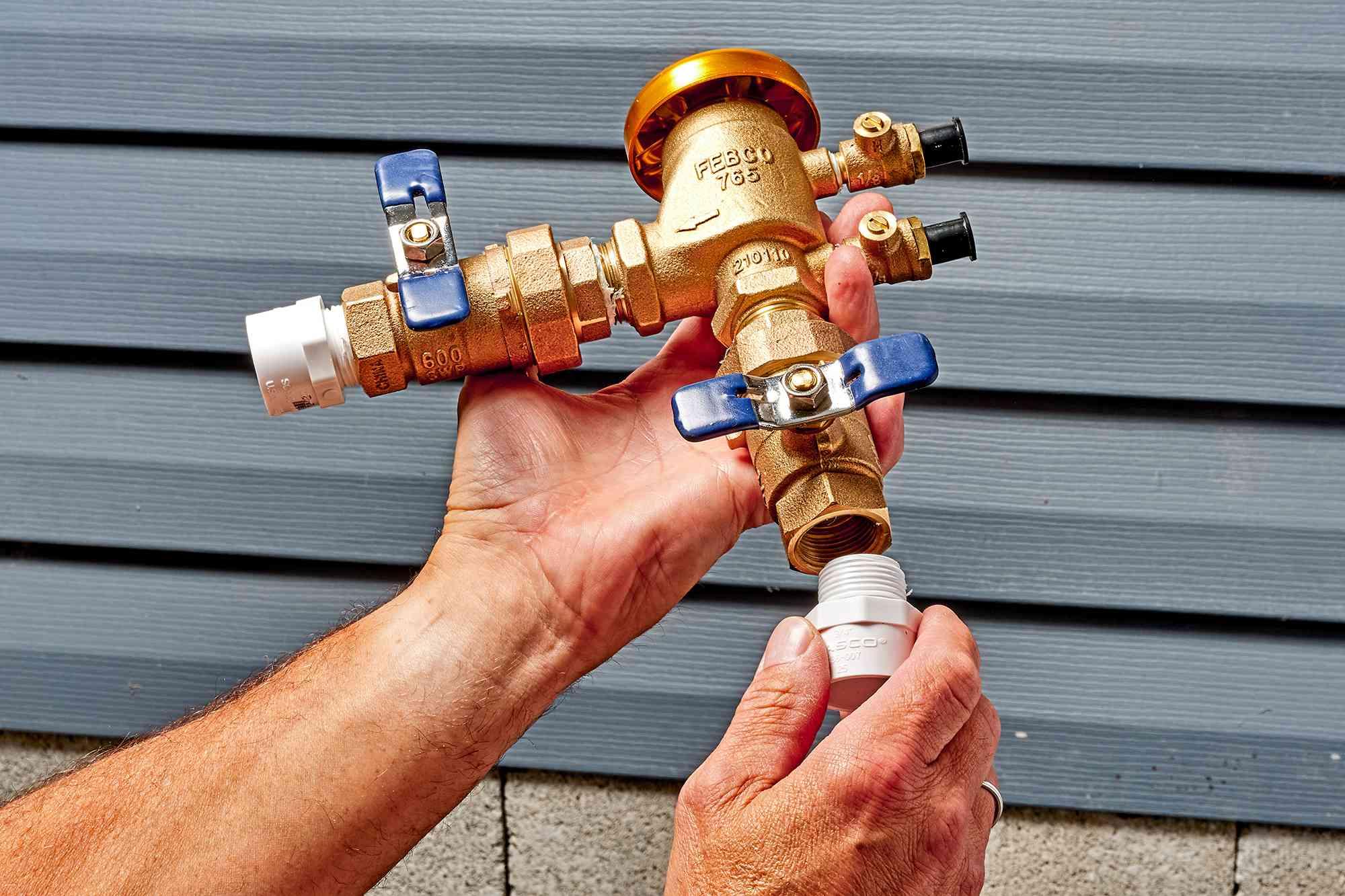 Male adapters threaded on each end of pressure-vacuum breaker