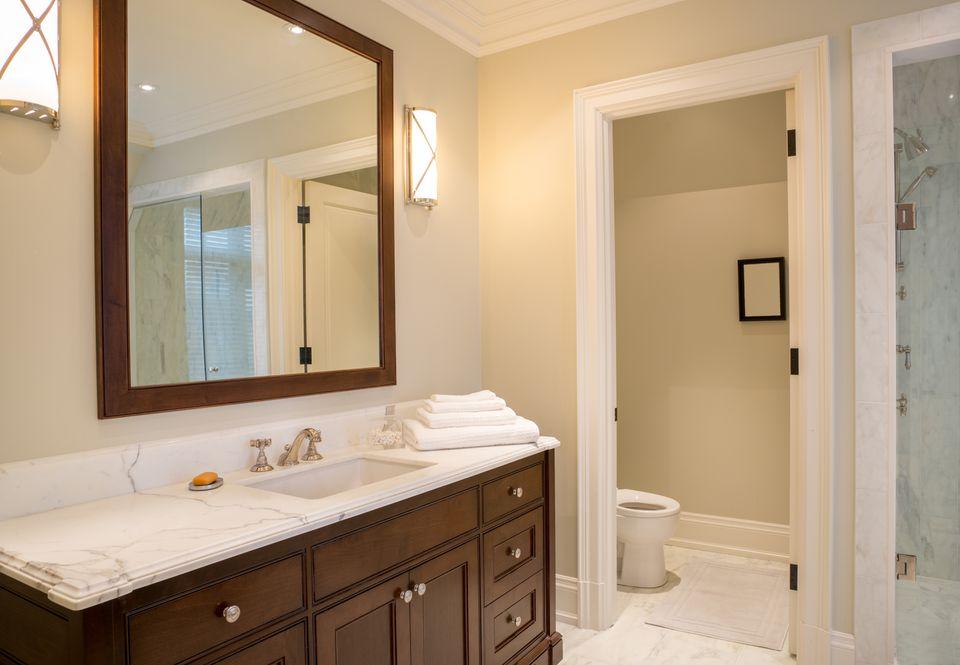Bathroom with framed mirror on wall