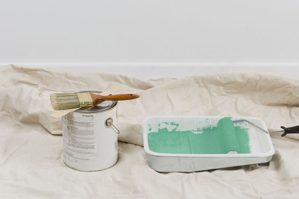 Can of paint and tray filled with paint