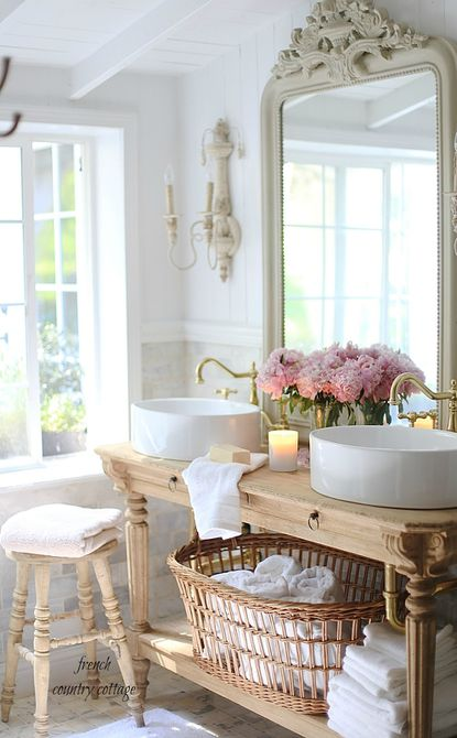 French country style bathroom with double sinks.
