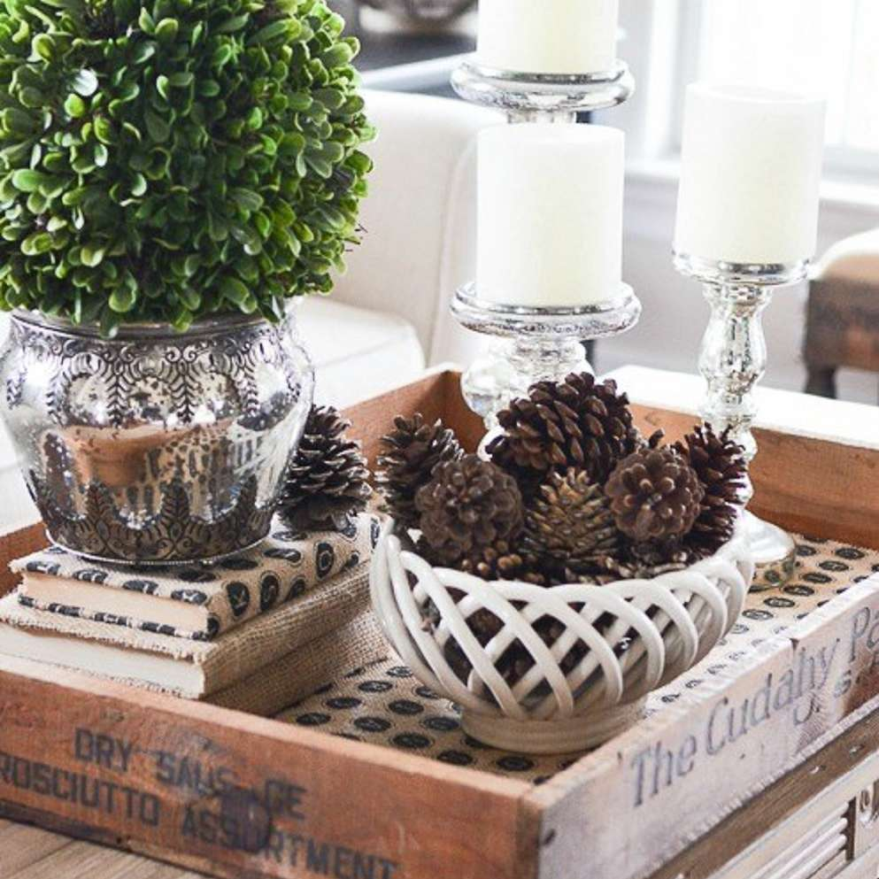 pinecones and candles on a coffee table for winter decor