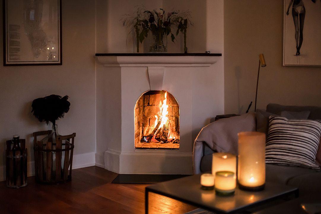 candles fireplace scandi apartment