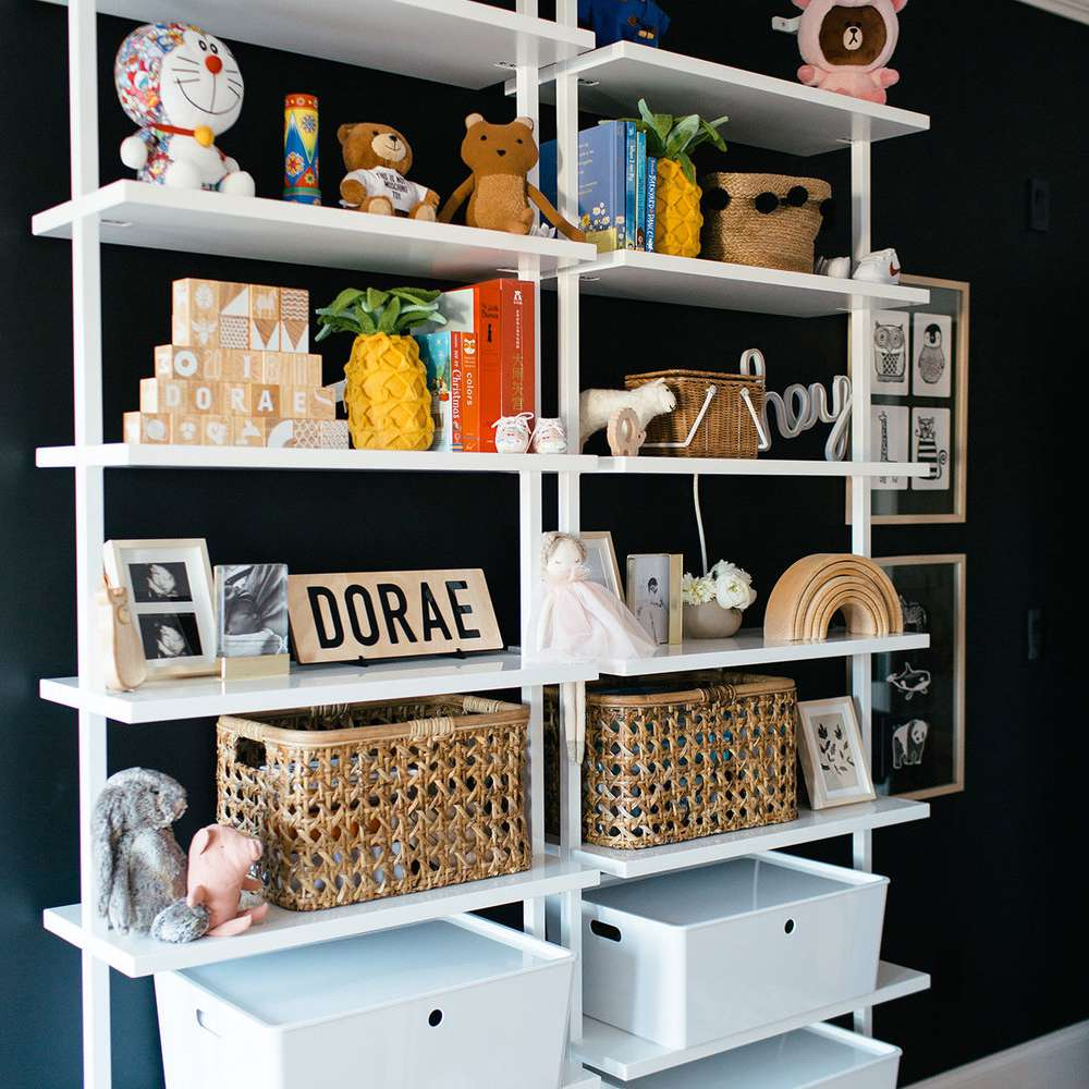 white shelving that goes floor to ceiling