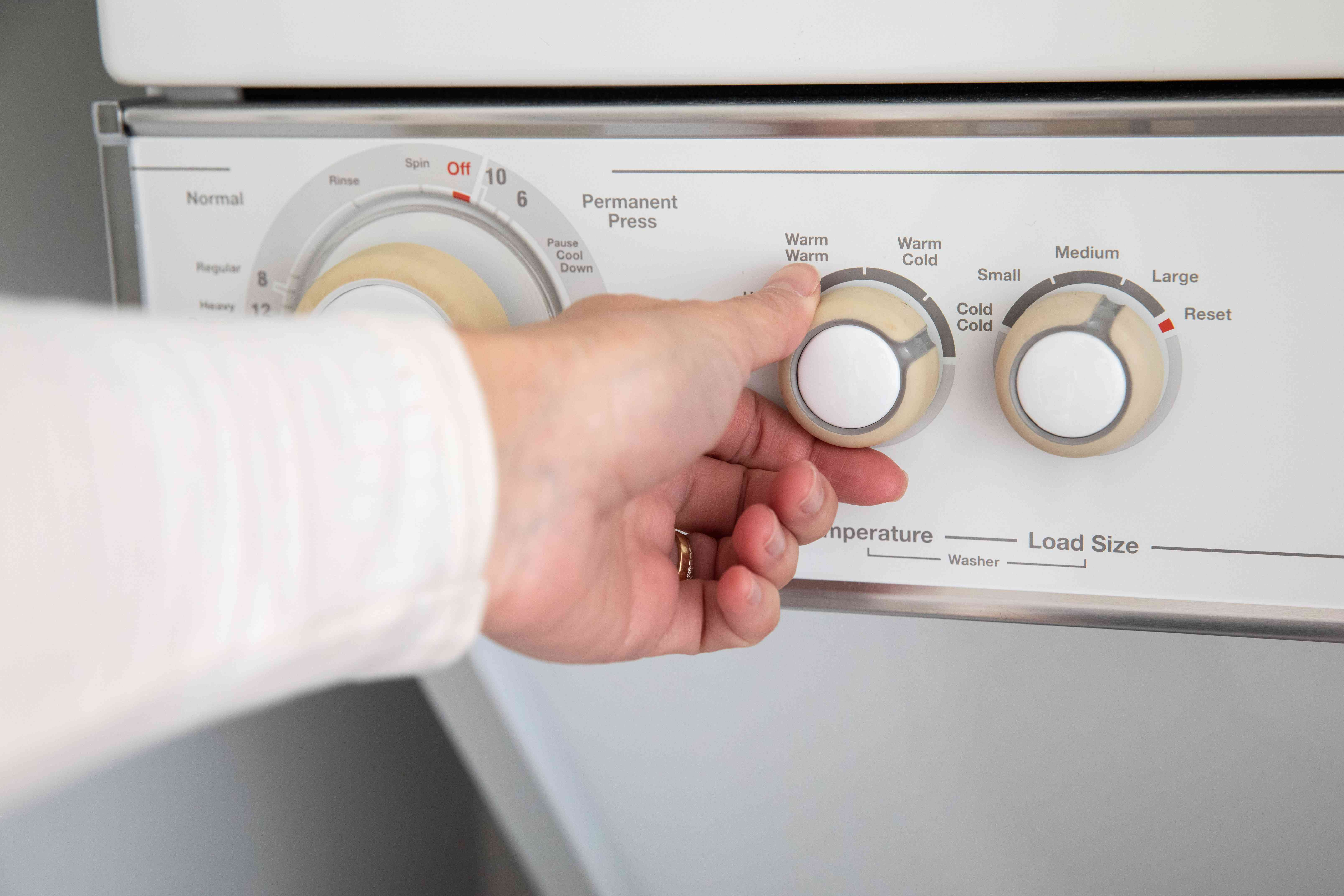 Clothes dryer set to lower temperature