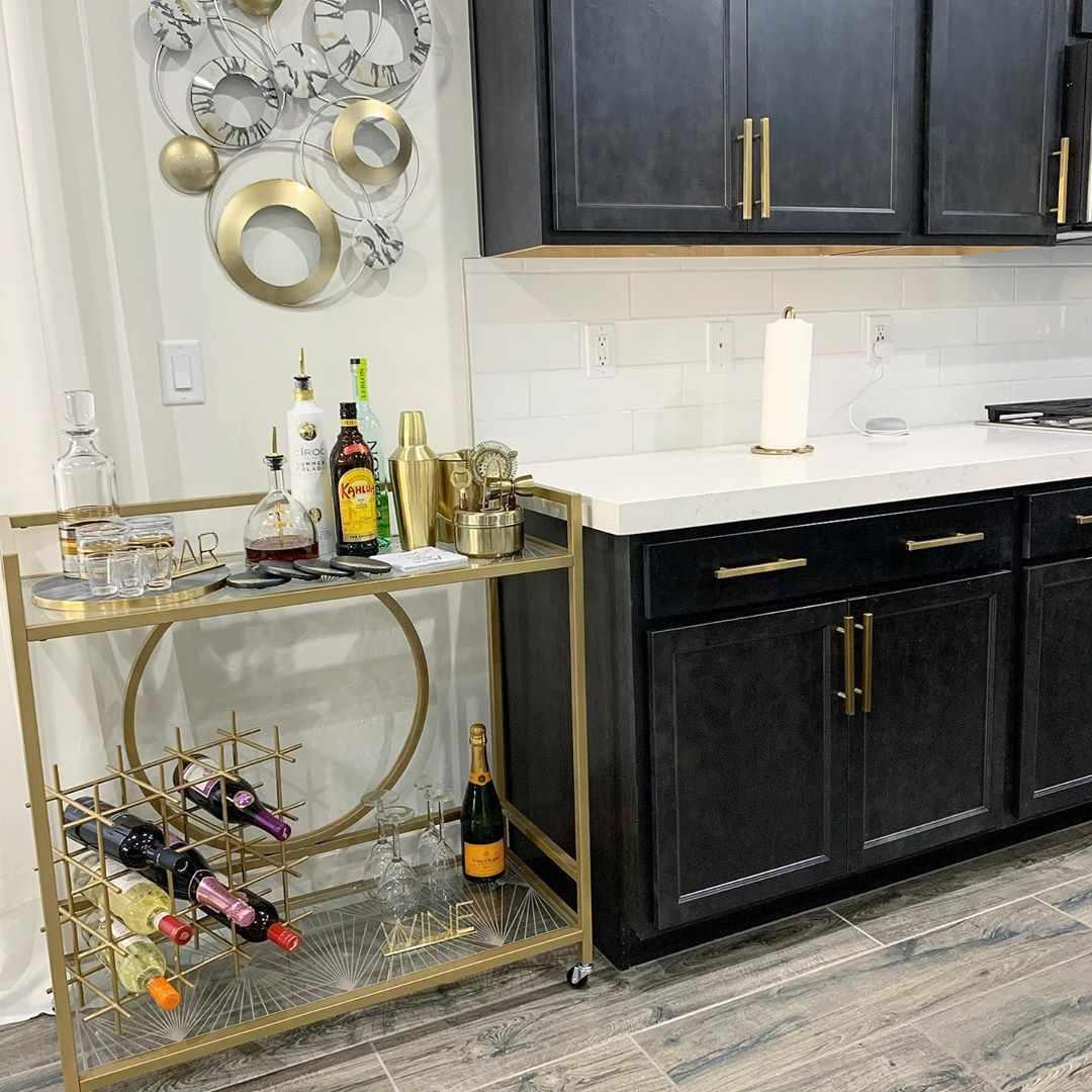 Gold bar next to a kitchen
