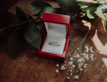 Wedding ring and band in red box