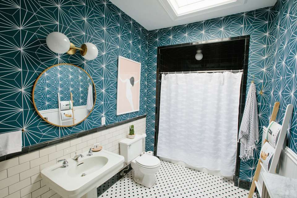 Chasing Paper's Peel and Stick Floor Tiles Collection in Starburst used on a bathroom wall