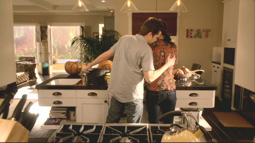 Cougar Town kitchen set with EAT art on walls