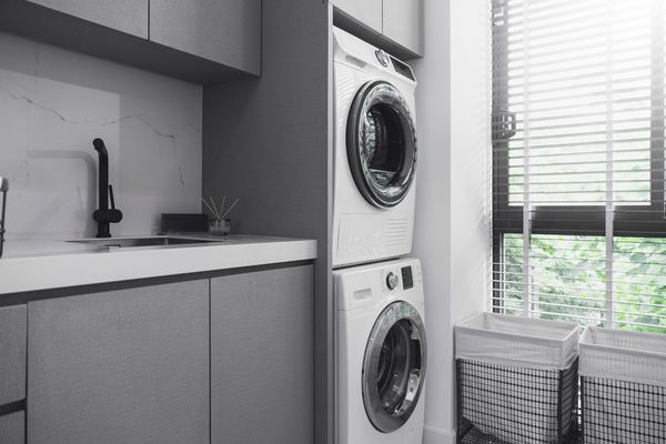 home interior design concept of Interior of A Modern Laundry Room with window wooden blind