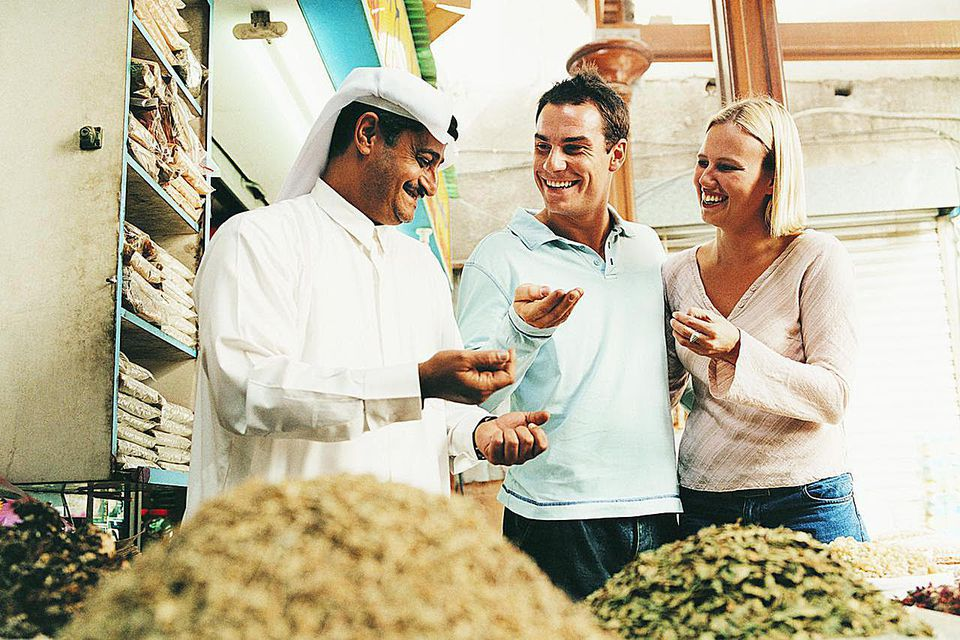 white couple buying local ingredients in foreign country