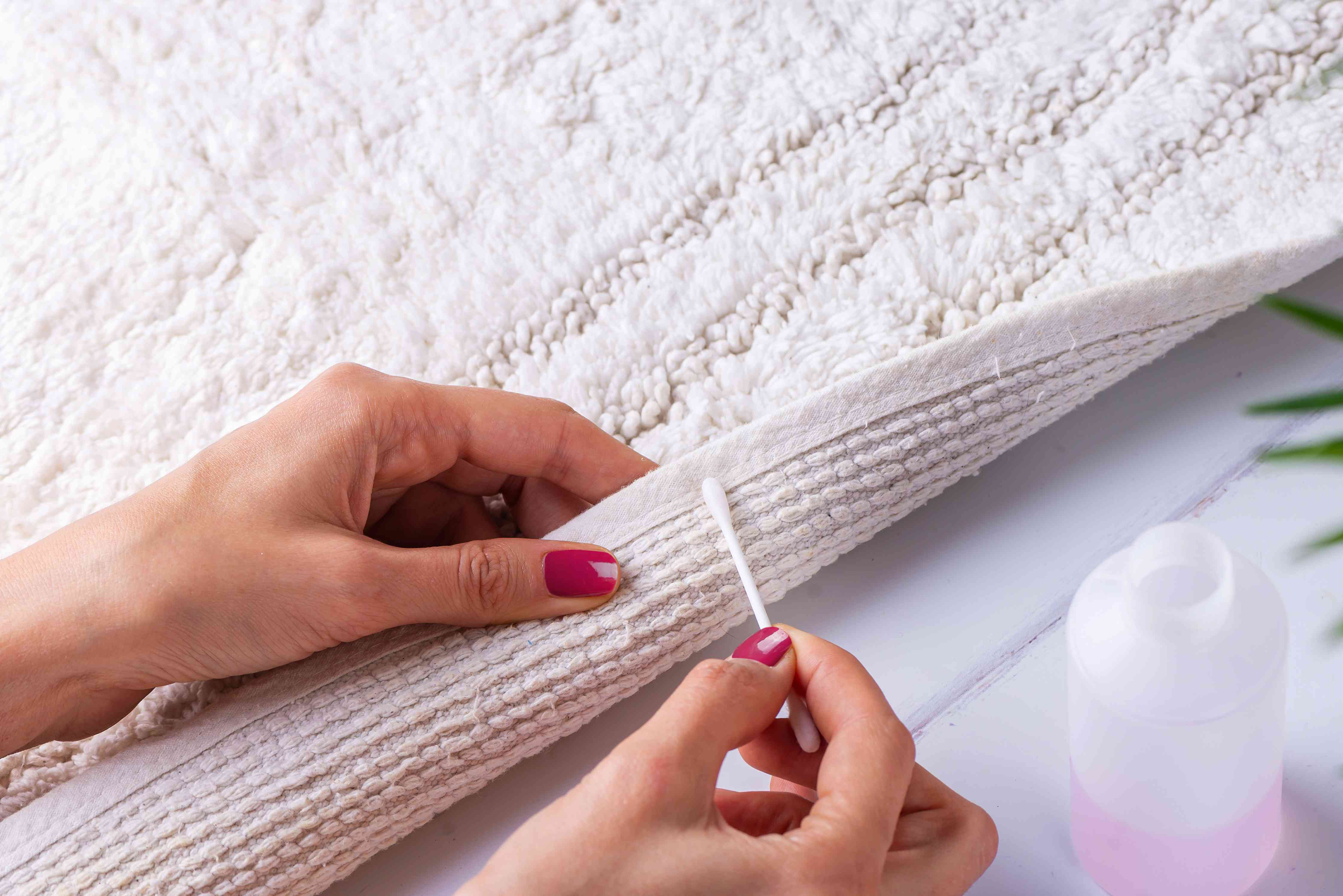 testing acetone on a hidden part of the rug