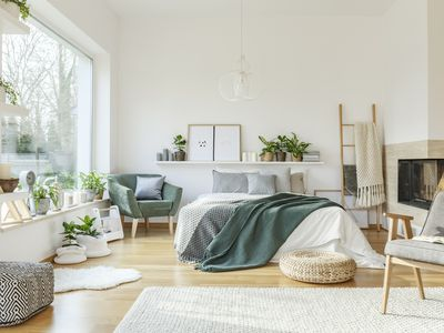 bedroom with white walls and plants