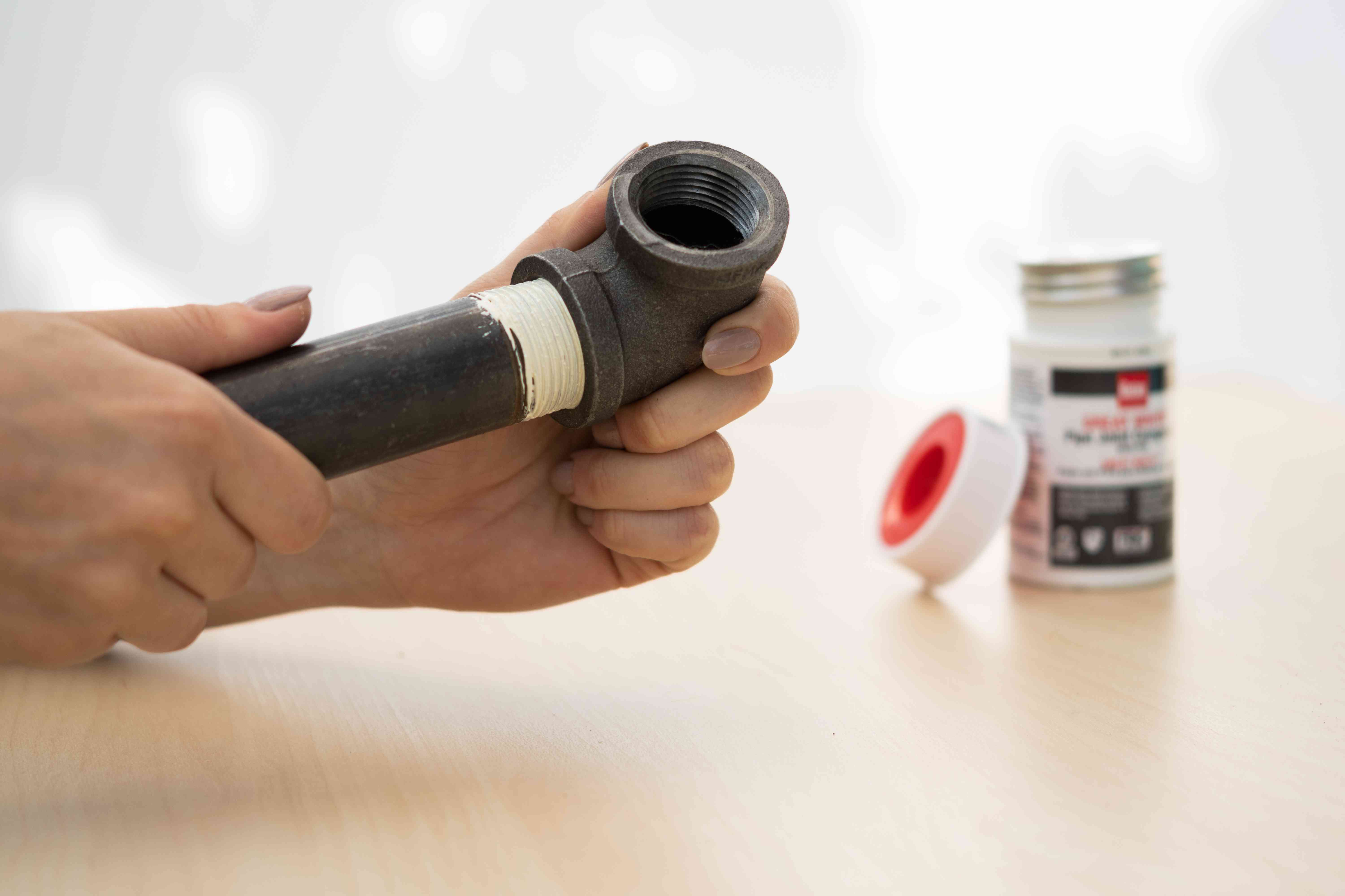 Pipe with pipe dope inserted into fitting and tightened by hand